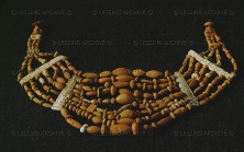 Collar of 390 amber beads, three perforated small stones and adorned bone slides, found on the breast of a female skeleton in grave 67 at the Duerrnberg, Hallein, Austria.